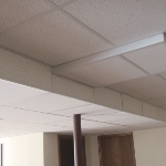 Drop ceiling covering ductwork and piping in basement