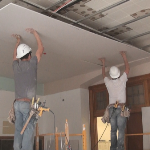 Installing drywall on a drywall suspension ceiling grid system