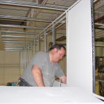 Installing ceiling tiles in a vertical drop for a suspended ceiling