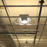 Light fixtures installing in a drywall suspended ceiling grid