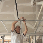 Installing a Drywall suspension ceiling grid system